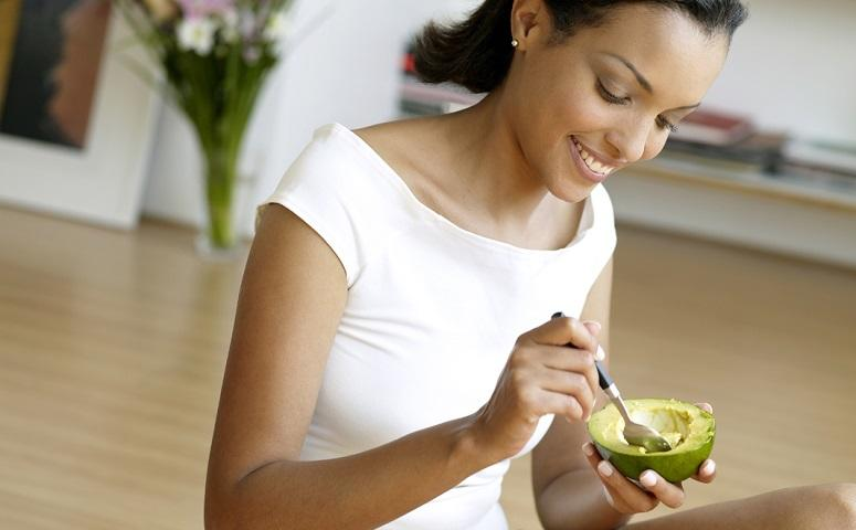 photo-of-woman-holding-avocado.jpg