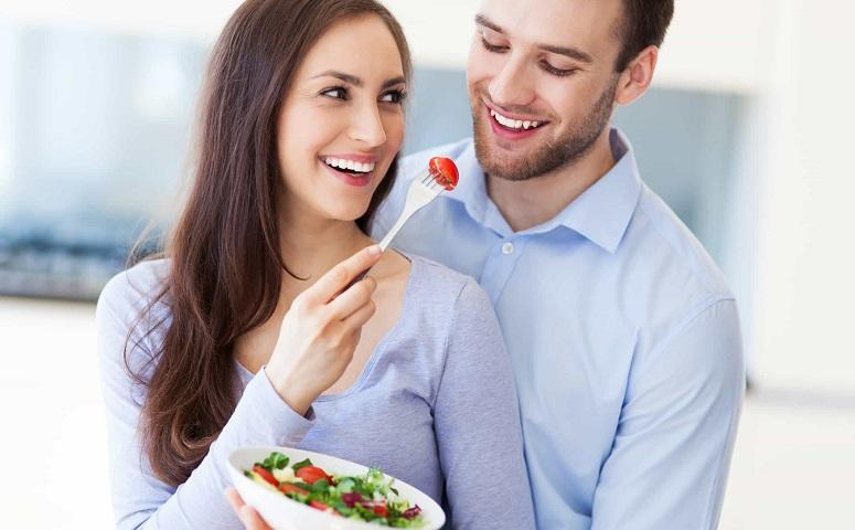 photo-of-happy-couple-eating-bowl-of-salad.jpg