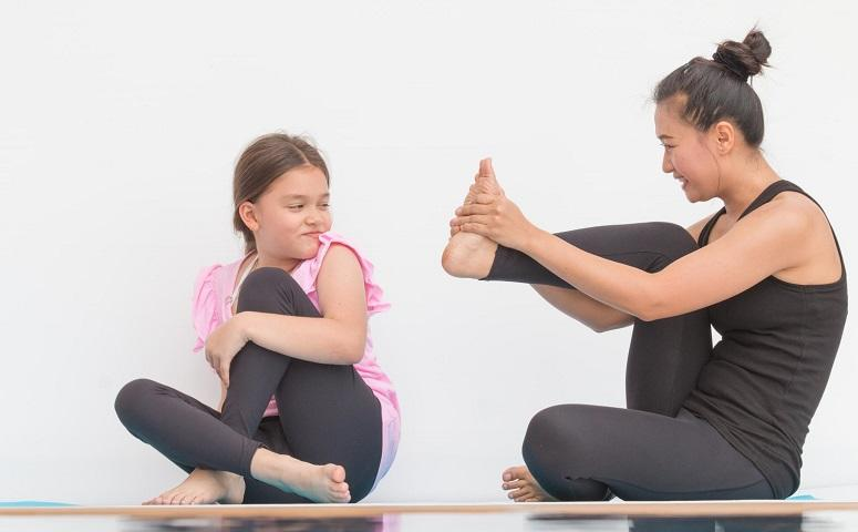 mom-and-daughter-do-yoga-together.jpg