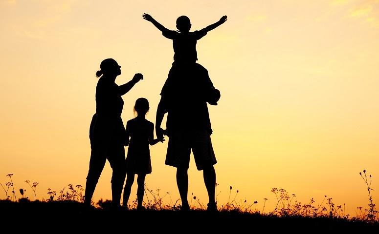silhouette-happy-children-with-mother-and-father-family-at-sunset-summertime.jpg