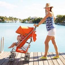 portrait-of-a-woman-pushing-baby-in-stroller.jpg
