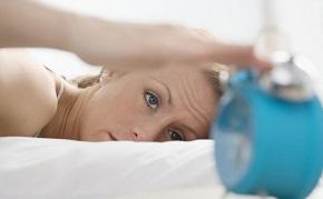 woman-in-bed-looking-at-alarm-clock.jpg