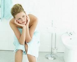 photo-of-woman-sitting-in-the-bathroom.jpg