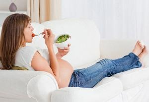 photo-of-pregnant-woman-holding-bowl-of-salad.jpg