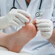 doctor-checking-patient-s-foot.jpg