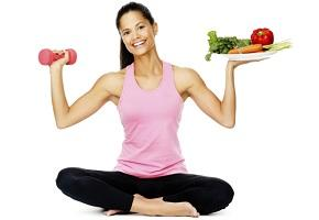 woman-holding-dumbbell-and-plate-of-vegetables.jpg