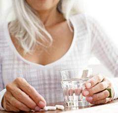 photo-of-a-woman-holding-glass-of-water-and-supplements.jpg