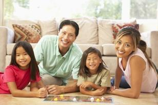 portrait-of-happy-family-playing-board-game.jpg