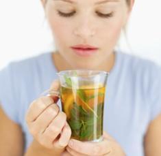 woman-holding-glass-of-tea.jpg