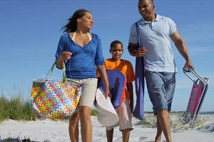 healthy-african-american-parents-young-son-arriving-holiday-together.jpg