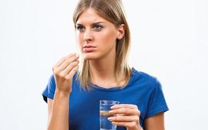 woman-with-supplement-and-water.jpg