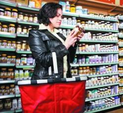 woman-holding-bottle-of-supplement.jpg