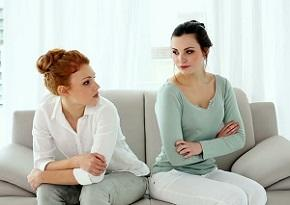 two-women-sitting-on-couch.jpg