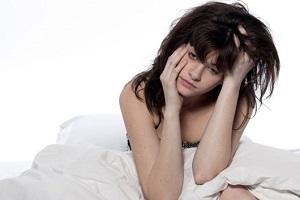 stressed-woman-holding-her-head.jpg
