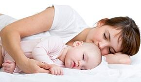 woman-sleeping-with-baby.jpg
