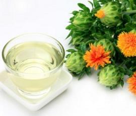 bowl-of-safflower-oil-and-safflower-plant.jpg