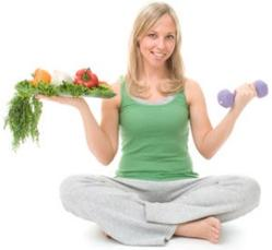 photo-of-woman-holding-dumbbell-and-food.jpg