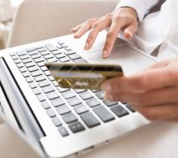 woman-using-laptop-and-holding-credit-card.jpg