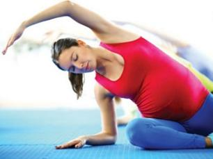 photo-of-a-pregnant-woman-exercising-yoga.jpg