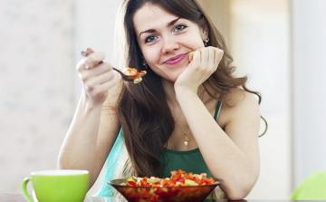 photo-of-woman-holding-spoon-with-food.jpg