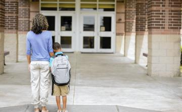 photo-of-woman-with-child-in-front-of-the-school.jpg