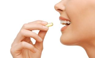 Woman Holding CLA Supplement
