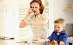 mother-talking-to-phone-with-child-on-her-side.jpg
