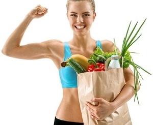 Fit Woman Holding Basket of Food