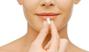Woman Holding Pill Supplement