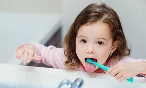 Child Cleaning Her Tongue