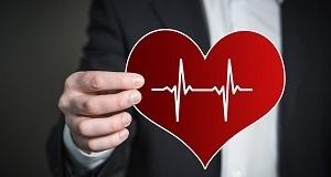 Man Holding Heart Figure