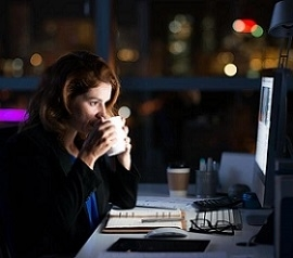 Woman Working at Night in the Office