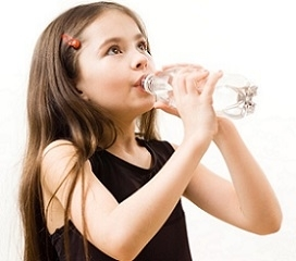 Child Drinking Bottle of Water