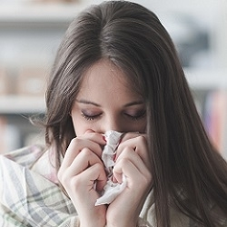 Woman With Keto Flu Covering Her Nose