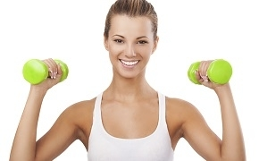 Happy Blonde Woman Exercising with Weights